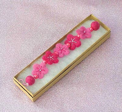 pink felt flower bracelet by roses felt workshop