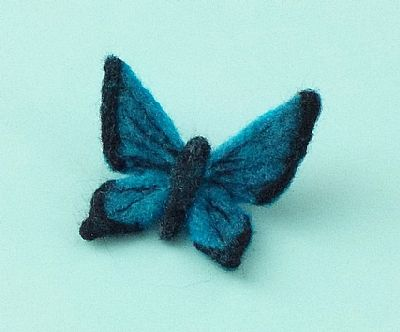 blue butterfly elt brooch by roses felt workshop