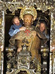 Dena and Lisa hug St James in Santiago de Compostela