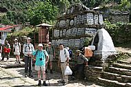 At a Mani Stone and Prayer Wheel