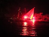 Two boats lit up for the Catelan celebration of St John the Baptist's day at Banyuls