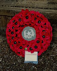 Wreath laid by George Leadbetter.