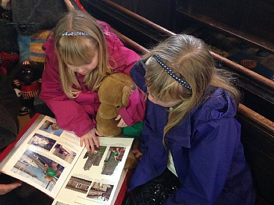 me with two of the children, reading my book