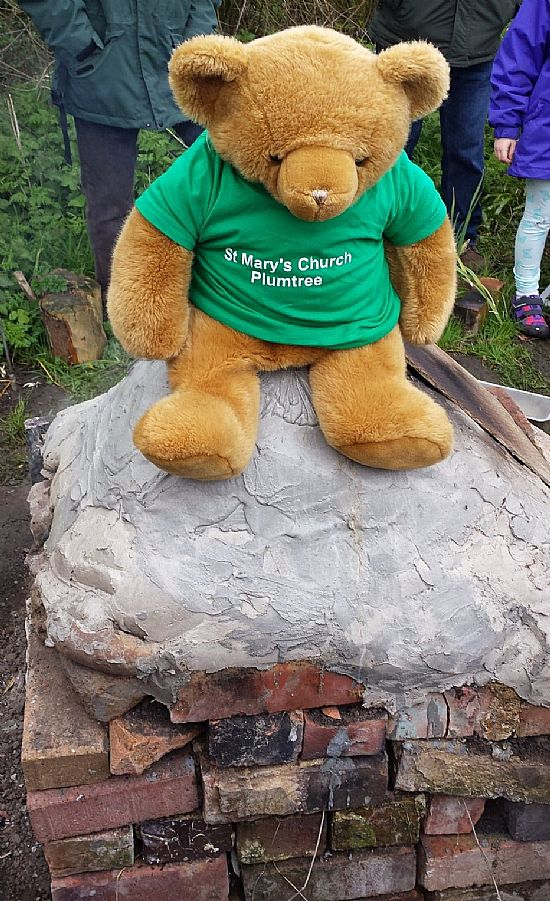 big ted sitting on a bread oven