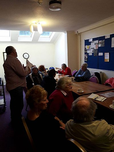 leon, ceo of trading standards, addressing timebank members.