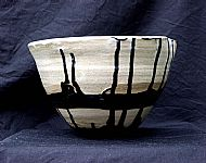 Bowl with black vertical lines