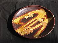 Plate with flowers and yellow lines