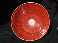 Interior of large red bowl
