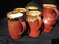 Four wheel-thrown mugs plus jug