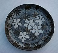 Platter with five white flowers plus acer leaves