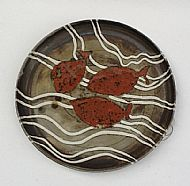Platter with fish and white lines decoration