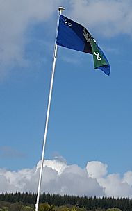 Regimental flag above Cairn.