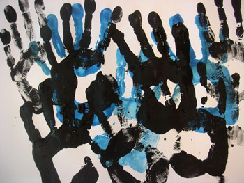 a painting made of hand prints