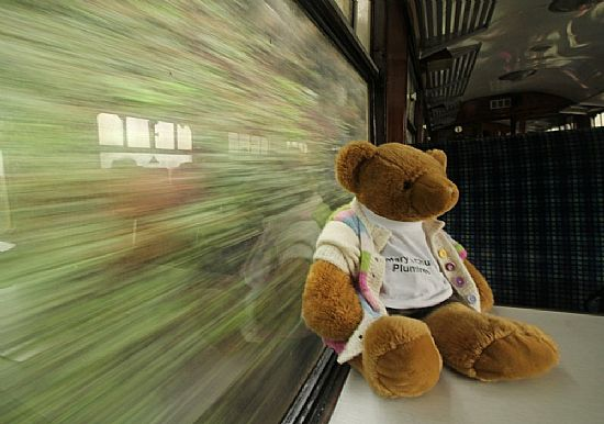 me, hurtling through the countryside on a train