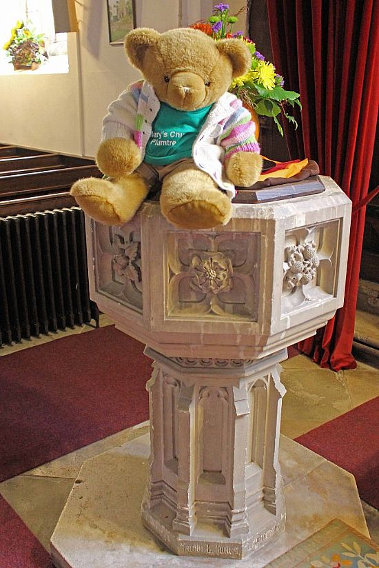 big ted sitting on font
