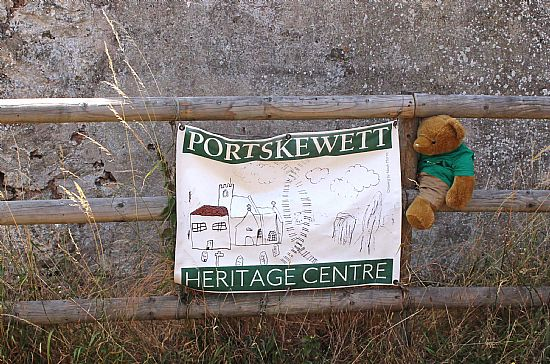 big ted sitting next to portskewett heritage centre sign