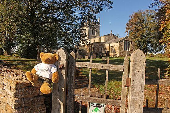 big ted sitting on church wall