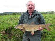 John Steele with a 12lb 4oz barbel