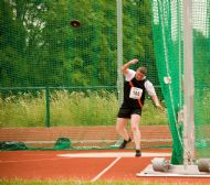 Craig Harris throwing a discus in London