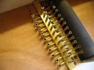 Underside of keyframe showing tubing connectors.