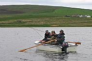 troutquest excursion. wild brown trout fishing by boat on loch hundland, orkney.
