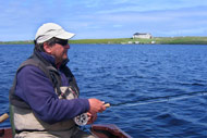 troutquest excursion. wild brown trout fishing by boat on loch boardhouse, orkney.