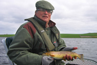 troutquest excursion. wild brown trout fishing by boat on loch swannay, orkney.