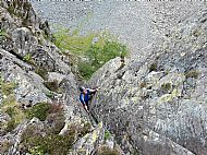 Charlie climbing Groove Two on Buckstone How - Lake District