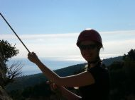Natalie enjoying the sun whilst lowering off La Budinetto Crag, Cala Gonone - Sardinia