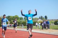 Ali Grigor from Fortrose Academy crossing the finish line in the 400mtrs.Athletics Championships 2009