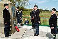 A wreath is layed at the Cairn