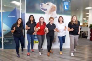 sales-i team members with Guide Dogs sign in background
