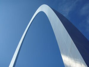 Blue sky with silver metal arch building