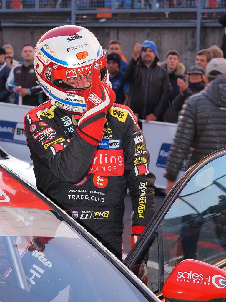 Jason Plato at the BTCC getting into his race winning sports car.