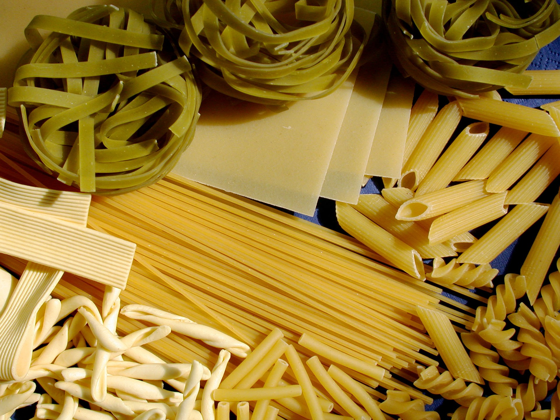 Different types of pasta - penne, spaghetti and farfalle