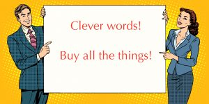 "A man and a woman hold up a sign that says ""Clever words! Buy all the things!"""