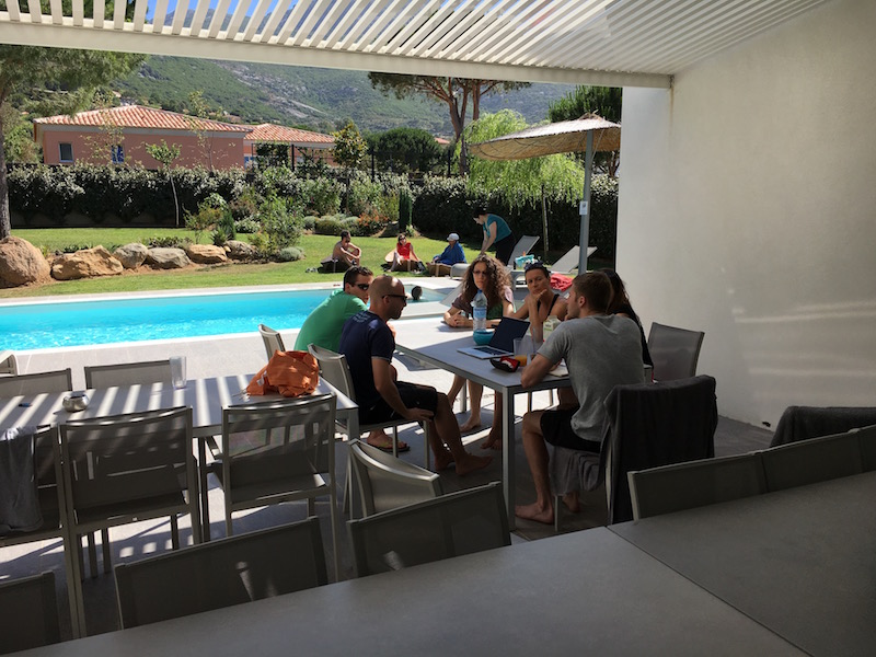 The team chilling by the pool in one of the villas