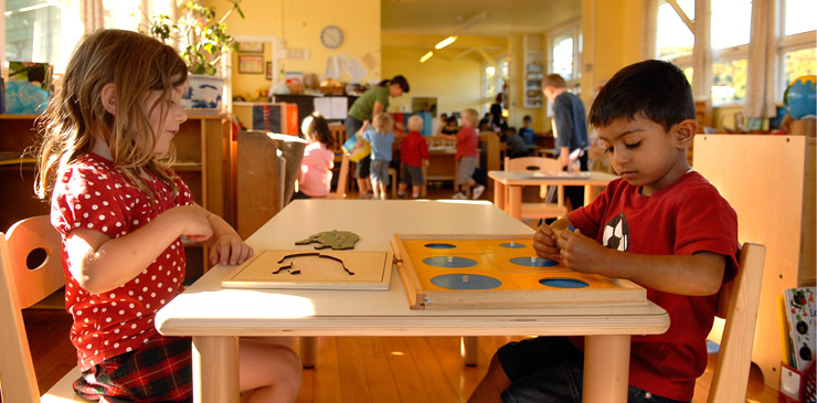 Children learning by doing in a Montessori school