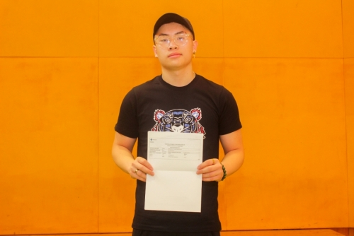 Hieu Pham celebrates his 3 A* grades and will be reading Economics