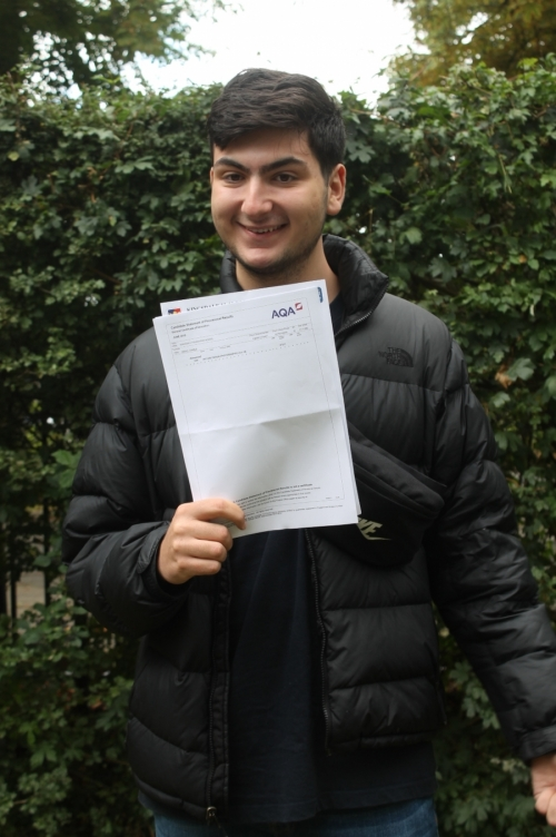 Ismael Chabeb celebrates his A* grades in English Literature, Spanish and Art & Design