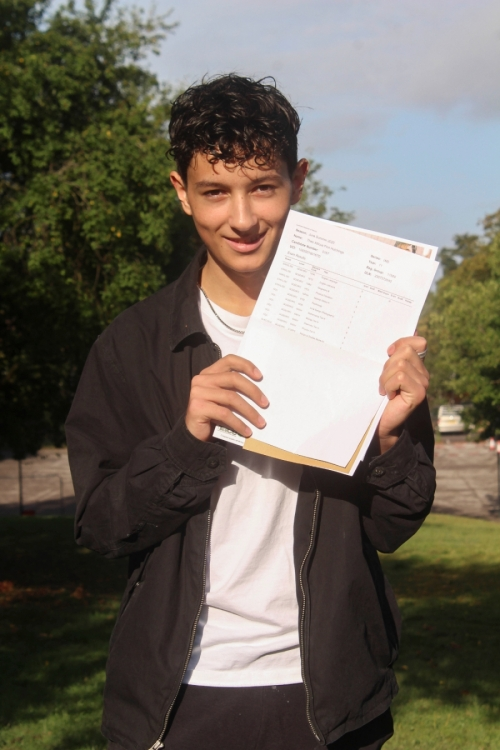 Theo Hutchings celebrates his impressive GCSE results which include 4 Grade 9s, 4 Grade 8s and 2 Grade 7s