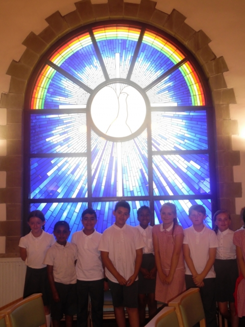 The beautiful stained glass windows in the Good Shepherd Church