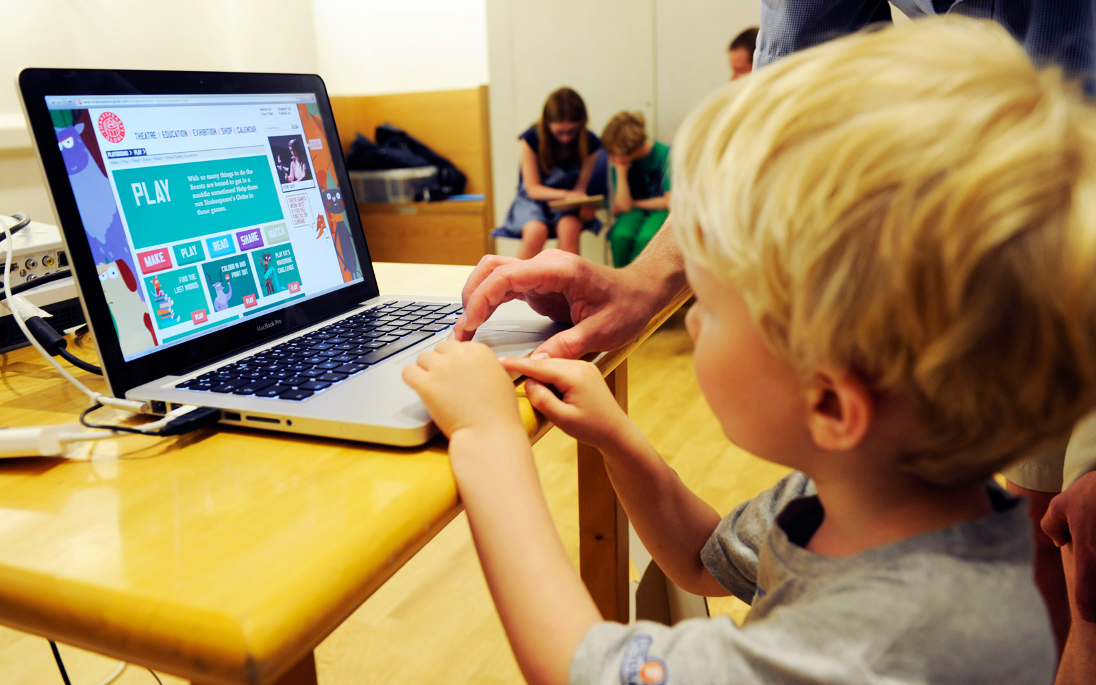 A young boy uses a laptop to browse learning resources