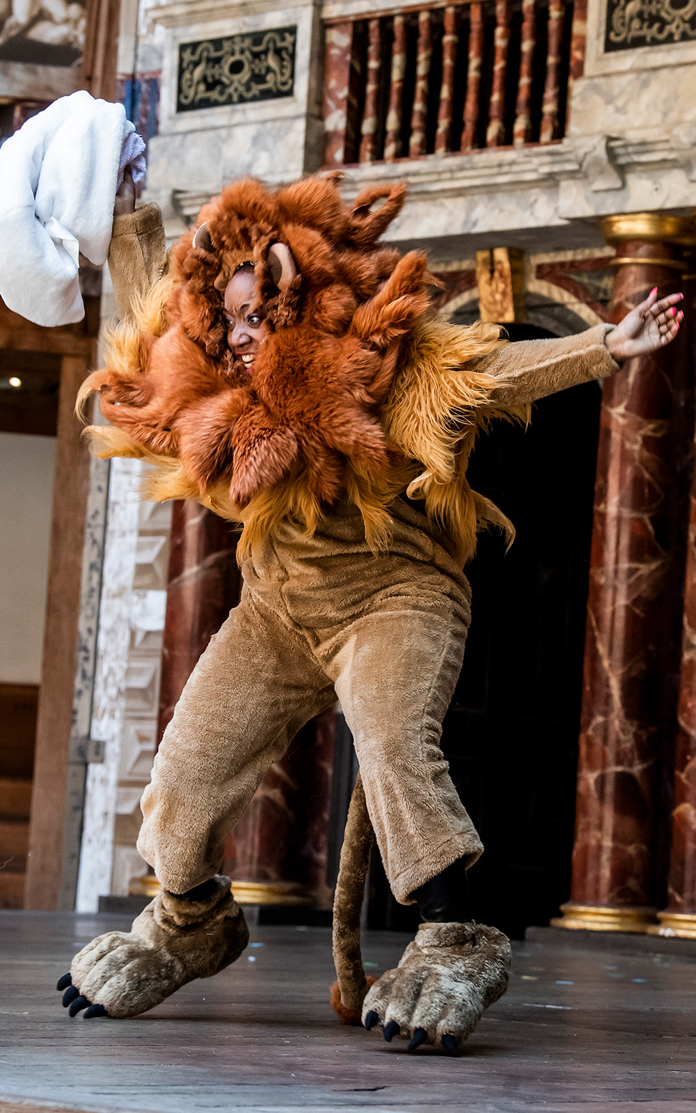 A person mid-air in a lion costume