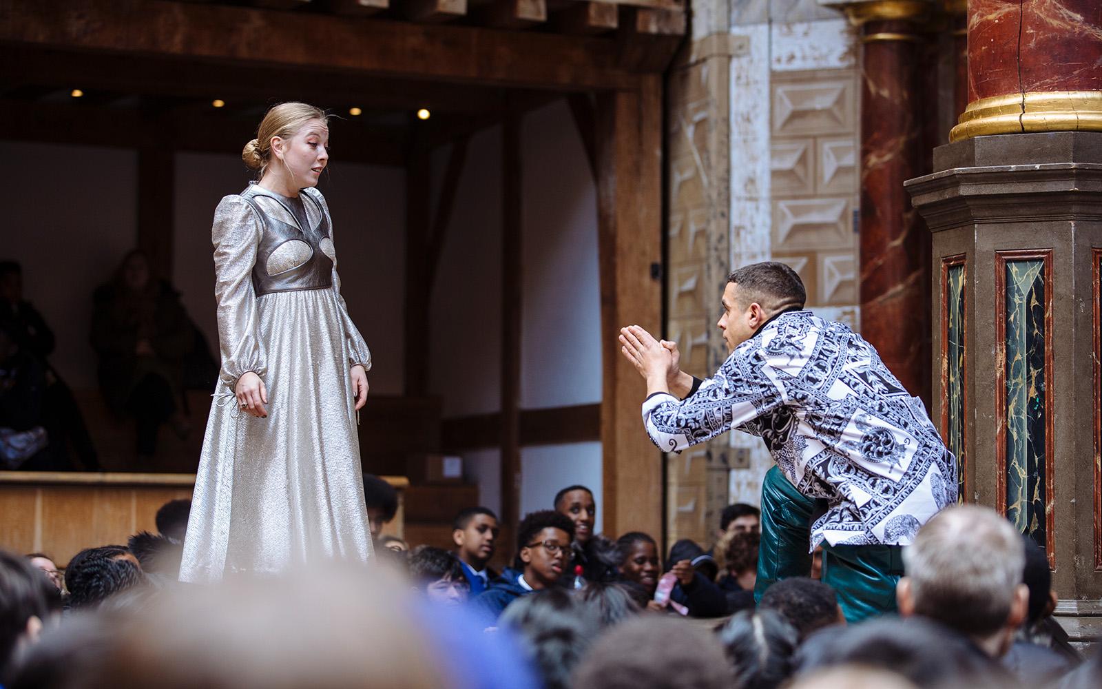 Romeo kneels praying to Juliet