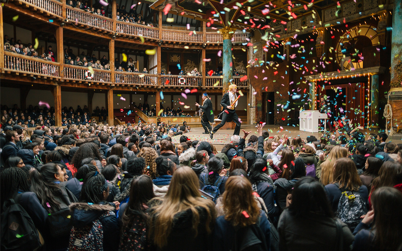 Confetti explode as Sir Andrew and Sir Toby run around the stage