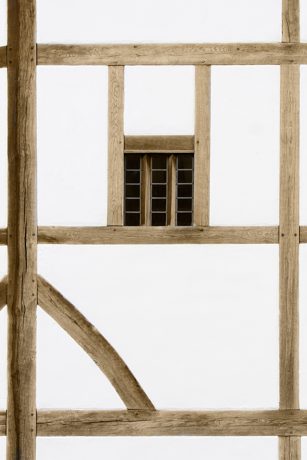 A white wall made with oak beams