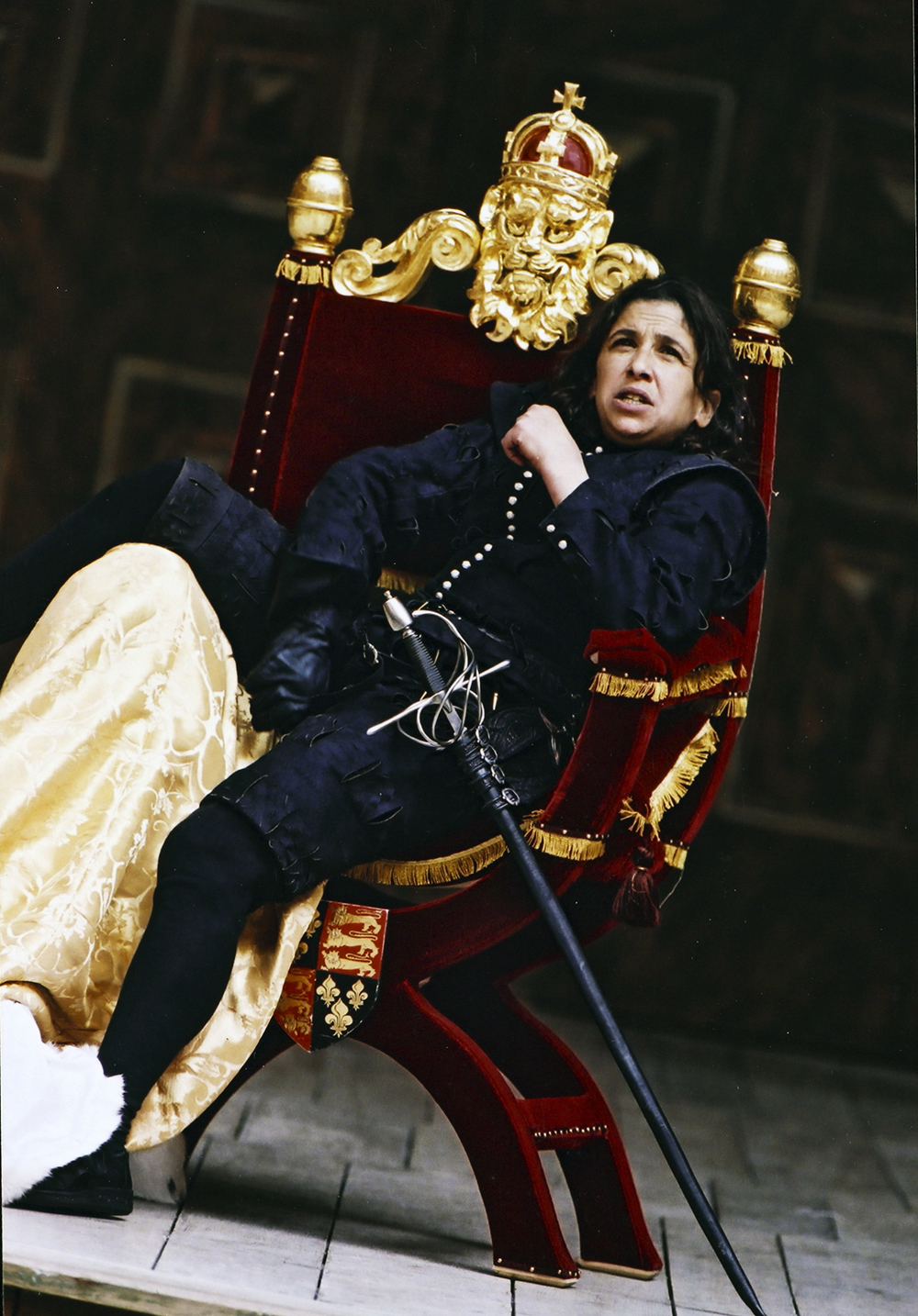 Actor sitting powerfully in a thrown