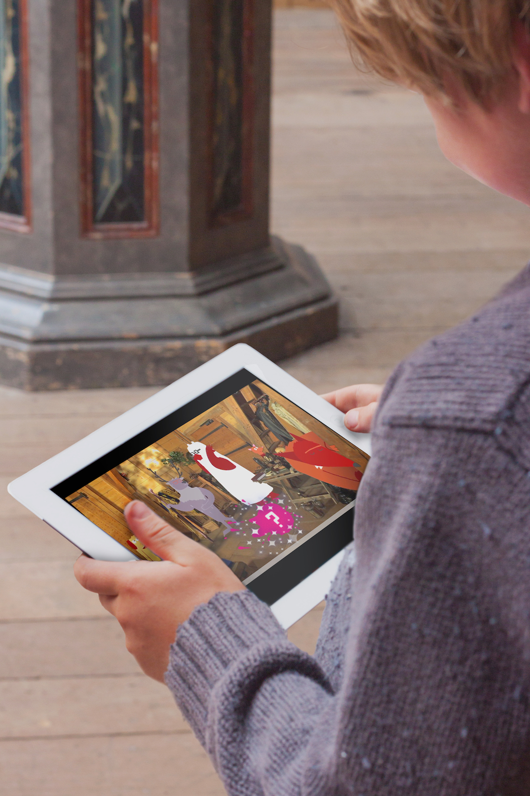A child watches a video on an iPad