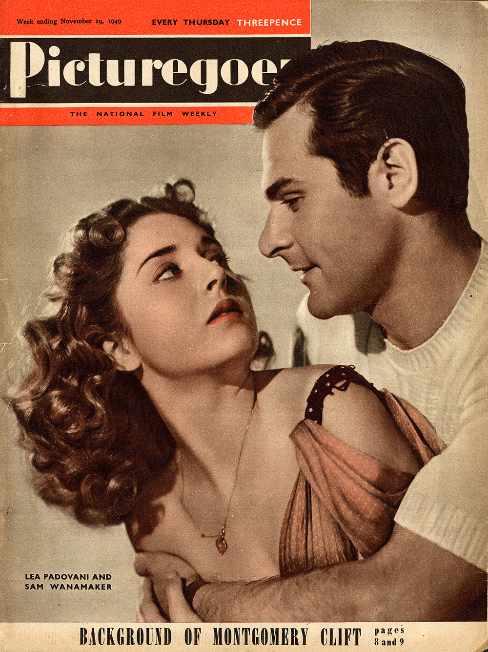 A poster of a woman looking over her shoulder at a man.